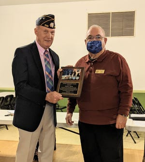 Pictured, George E. Halyak is presented with the Craven County Veterans' Council's Lifetime Achievement Award by Bob Cusick, president of the Craven County Veteran's Council. [CONTRIBUTED PHOTO]