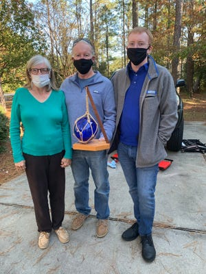 Julie, Bill, and Dane Madsen celebrated their first place win in Fairfield Harbour Yacht Club's Virtual Trivia Contest. [CONTRIBUTED PHOTO]