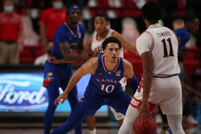 Kansas basketball forward Jalen Wilson guards Texas Tech's Kyler Edwards during the second half of last Thursday's game in Lubbock, Texas. Wilson's shot block with three seconds left secured the 58-57 victory for the Jayhawks.