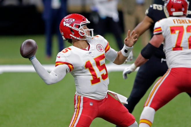 Kansas City Chiefs quarterback Patrick Mahomes (15) passes in the first half of an NFL football game Sunday against the New Orleans Saints in New Orleans.