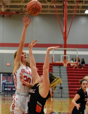Ballard's Cassidy Thompson flips a shot up over Carroll's Camryn Schable during the No. 3 (4A) Bombers' 40-22 victory over the Tigers Friday in Huxley.