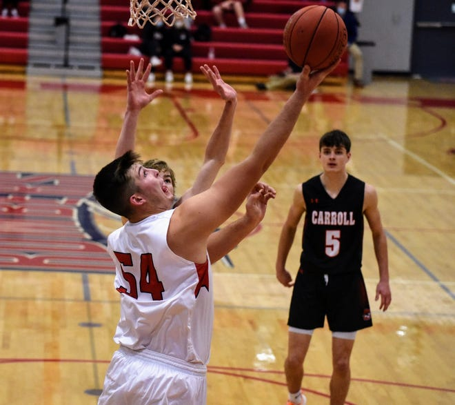 Ballard's Kale Krogh goes for a reverse layup during the No. 2 (3A) Bombers' 59-58 overtime loss to No. 3 Carroll  Friday in Huxley. Ballard regrouped to pound Kuemper Catholic on Saturday at Huxley, 87-49.