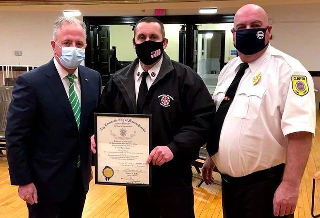 Clinton Fire Captain Jason Burton (center) with Rep. Harold Naughton (left) and Fire Chief Michael Lutes.