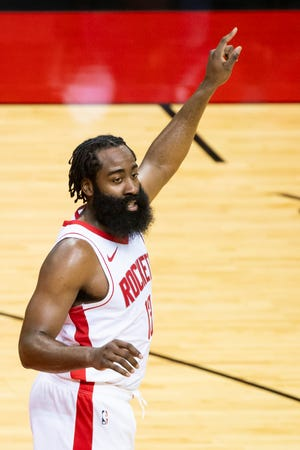 Houston guard James Harden yells directions to his team during the third quarter of a preseason NBA basketball game last Thursday.