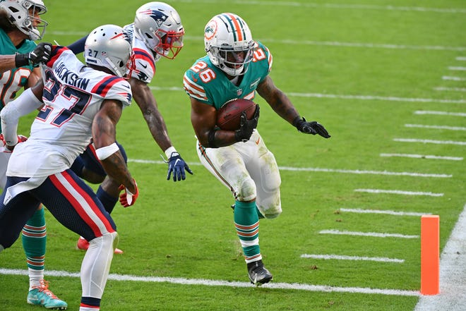 Dolphins running back Salvon Ahmed (26), who finds the end zone here on a 2-point conversion, rushed for 122 yards Sunday against the Patriots.