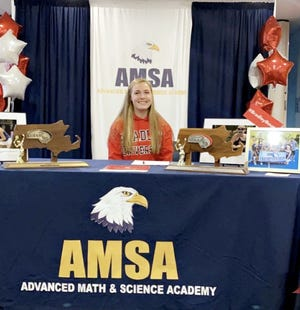 Kirstin Hailey signs her letter of intent to compete for Bradley University.