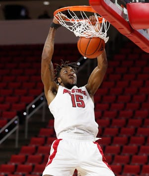 Fayetteville native Manny Bates is averaging 15 points, 6.5 rebounds and five blocks over his last two games for the Wolfpack, which is set to welcome UNC to Raleigh on Tuesday night.