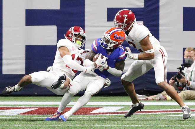 Florida receiver Kadarius Toney makes a catch at the goal line Saturday against Alabama during the SEC Championship Game at Mercedes-Benz Stadium in Atlanta. Toney finished the game with eight receptions for 153 yards.