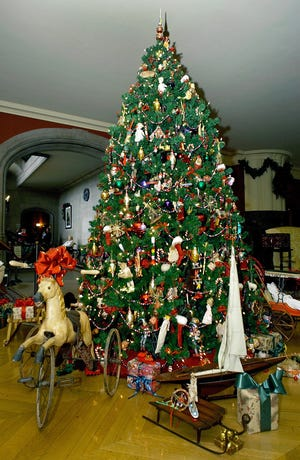 A decorated tree is shown surrounded by vintage toys in the children's room of the Biltmore House in Asheville, N.C.