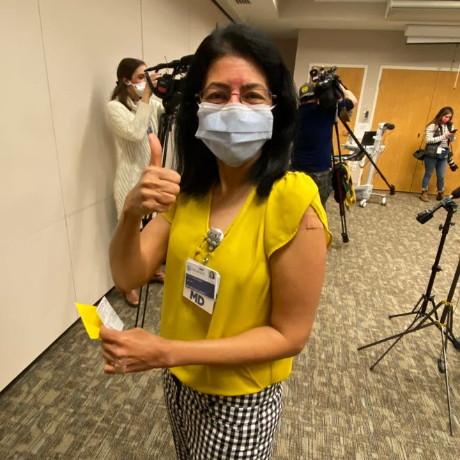 FILE - Dr. Jayashree Ravishankar, an infectious disease doctor at ARMC, received her first dose of the COVID-19 vaccine Friday, Dec. 18, at Cone Health's Green Valley Campus in Greensboro.