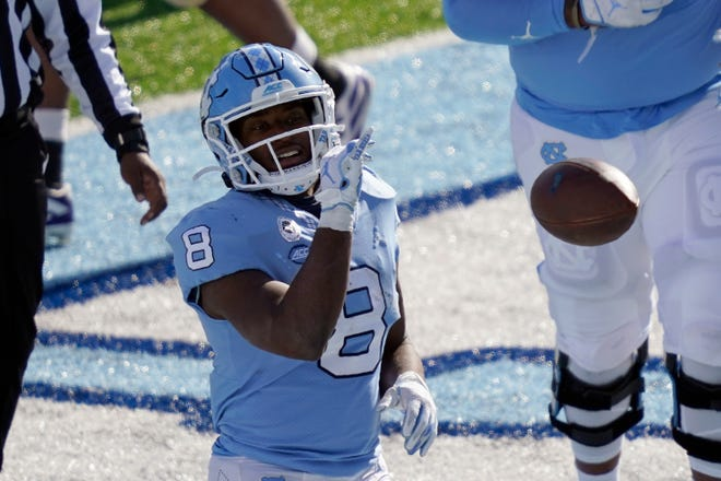 North Carolina running back Michael Carter celebrates a touchdown during a victory against Western Carolina earlier this month.