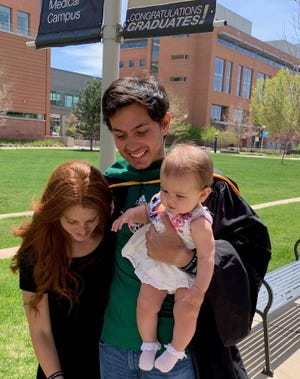 Alejandro Marin, pictured with his wife Andrea and daughter Itziara at his recent graduation from medical school. Marin has been named a CSU Pueblo Distinguished Young Alumni.