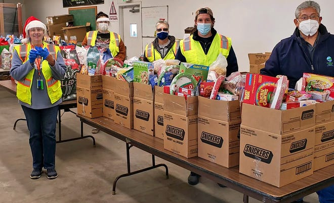 Santa's Elves, aka Pueblo West Metropolitan District and Parks and Recreation staff, load boxes of food Saturday for the annual Christmas Food Basket program which benefitted 63 families.