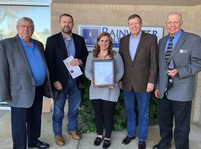 Rainwater Holt & Sexton Law Firm in Little Rock received an appreciation award from the Arkansas Military Veterans Hall of Fame on Wednesday, Dec. 9,  for their Saluting Heroes donation. Pictured are Keith Greene, left, of Alma, along with Bob Sexton, Lynette Panique, Mike Rainwater and Dwight Witcher.
