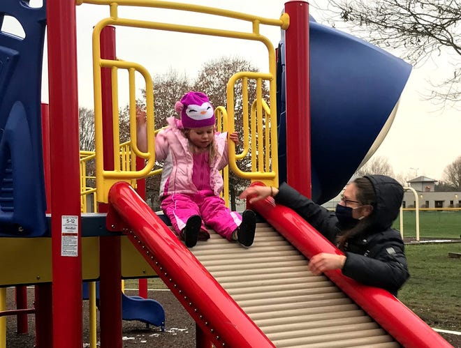 Brooke Hachat of Delaware and her daughter, Eliana, took advantage of a break in the weather Dec. 19 to enjoy the playground equipment at Mingo Park, 500 E. Lincoln Ave.