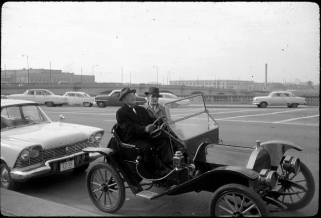Albert M. Miller, board chairman of the Ohio Paper Co., and Columbus Mayor M.E. Jack Sensenbrenner sit in a 1909 Hupmobile before leading a procession across the newly opened Third Street viaduct Dec. 15, 1959. Through the years, several bond issues were placed on the ballot to pay for the construction of a viaduct to connect the north side of Columbus to downtown but failed. It took more than half a century for the link over the Union Depot yards to become reality when its construction was tied to that of a multi-million-dollar expressway system.