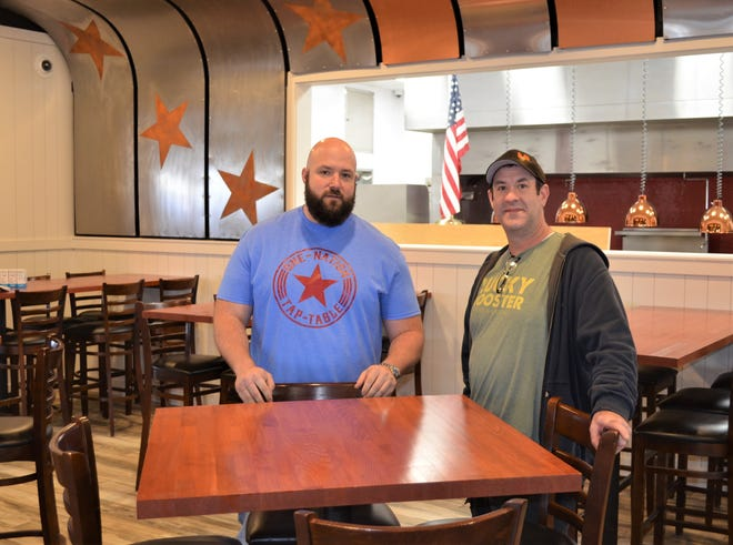 Owner Stephen Titus, left, and chef Trent Mead give the Enquirer an early look at one of the newest restaurants in town - One Nation - Tap & Table.