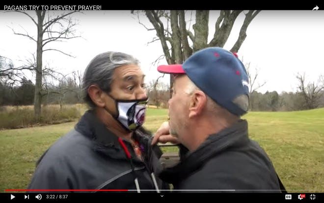 A screen capture from a video shows Philip Yenyo, the executve director of the American Indian Movement of Ohio, left, and a member of Pass the Salt ministry at the Great Serpent Mound on Sunday.