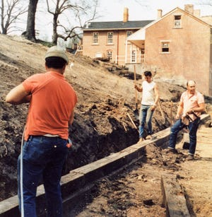 """Ledonis """"Don"""" Daliere, far right, oversees work on a hillside near the the stage area in Roscoe Village. He was hired by Edward and Frances Montgomery to do much of the work in the recreation of a canal era town, earning him the nickname of the Building Artist."""