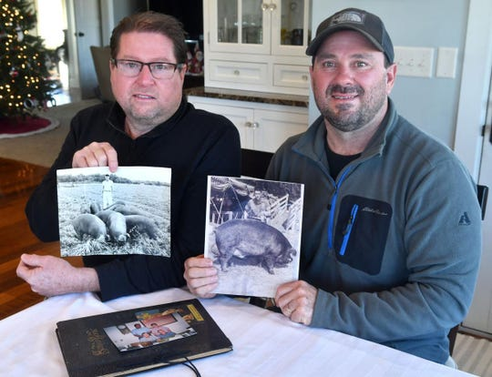 Jeff and Brett Grings of Wilton holds photos of their father Jerry Thomas Grings who died on Nov. 28, 2020 at UnityPoint-Trinity Bettendorf hospital from complications with COVID-19.
