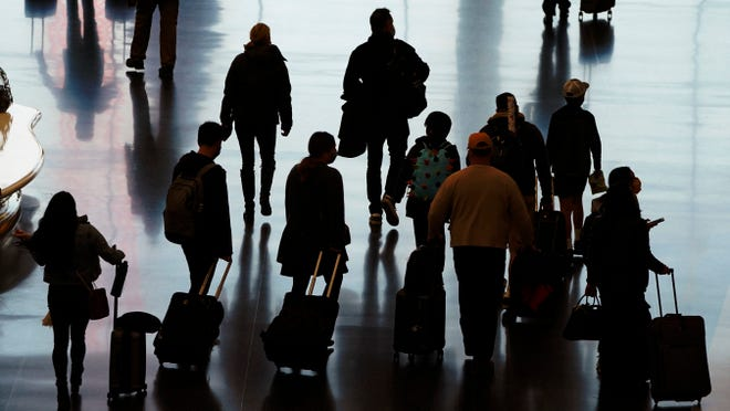 More than 1 million people have passed through U.S. airport security checkpoints in each of the past two days in a sign that public health pleas to avoid holiday travel are being ignored, despite an alarming surge in COVID-19 cases. (AP Photo/Rick Bowmer, File)
