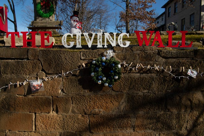 The Giving Wall on State and Gray streets in Newburgh, Ind., is one of many such places people are using to give to those in need.