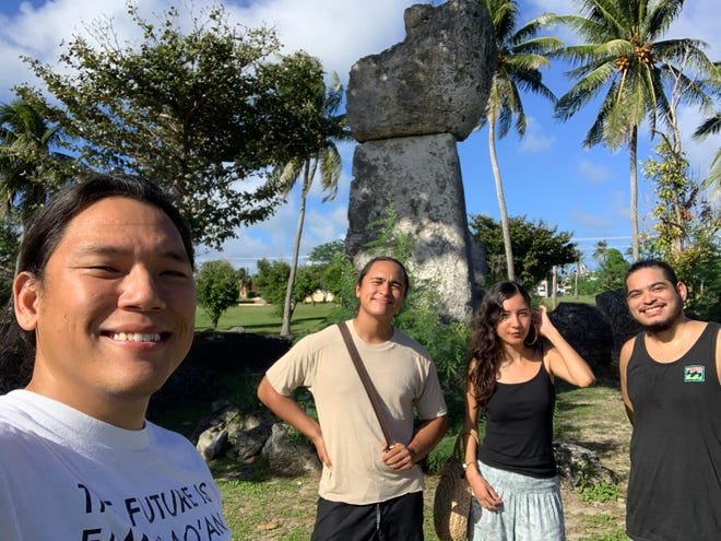 Tåhdong Marianas members, from left, Andrew Gumataotao, Aaron Santos, Samantha Barnett and Lawrence Lizama, pose at the House of Taga in Tinian in November. The group visited the island to film for their project featuring Marianas-based musicians and cultural practitioners.