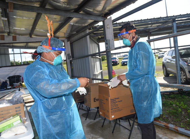 The Department of Public Health and Social Services holds mass community COVID-19 testing at the Tiyan carnival grounds in this Dec. 21 file photo.