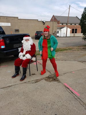 Santa and his elf get ready to hand out gifts to the 53 children in Union County.