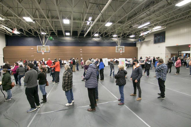 Voters wait in line inside a gymnasium in Hartland, Michigan, to vote on Election Day, Nov. 3, 2020.