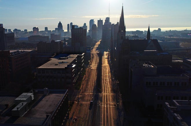 West Wisconsin Avenue is empty of vehicles through Marquette University, just west of the downtown Milwaukee skyline in Milwaukee on Thursday, April 2, 2020.