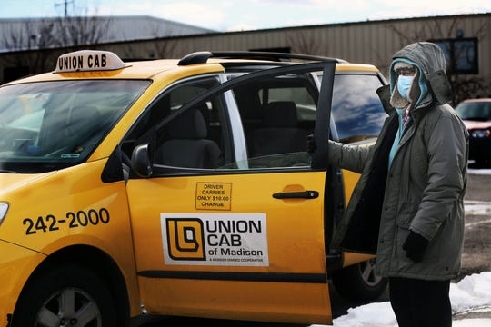 Nancy Weber arrives for her shift on Monday, Dec. 21, at Union Cab, where she has worked since 1999. In April the company received $690,000 in PPP loans with the hope of saving 180 jobs. By summer, the taxi company announced it was laying off 126 workers.