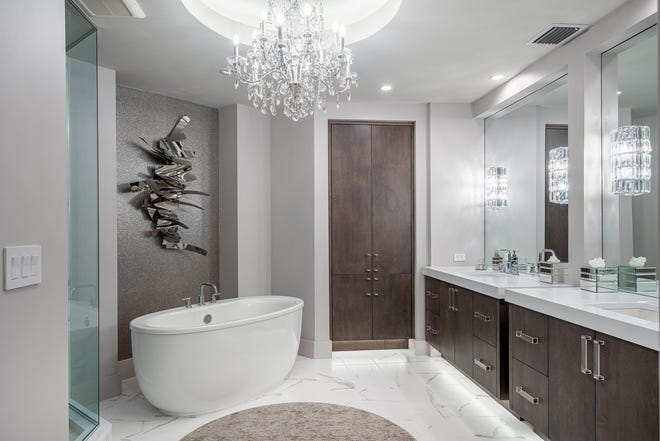 A dramatic master bath update combines clean-lined vanities, an elegant tub and a new linen closet.