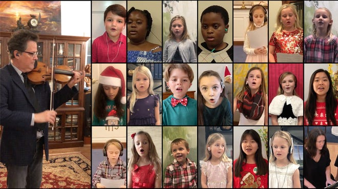 The children's chorus of First United Church of Christ of Christ in their Christmas performance, with Glenn Basham, violinist and Alexandra Carlson, pianist