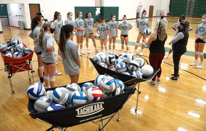The Novi High Wildcats varsity volleyball team hits the gym on Dec. 21, 2020 to prepare for the resumption of the state playoffs in the new year.