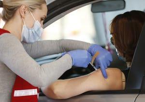 A nurse provides a COVID-19 vaccine at Dignity Health