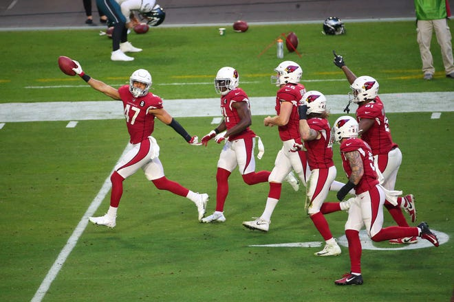 Arizona Cardinals' Ezekiel Turner (47) celebrates with teammates after catching a pass on a fake punt against the Philadelphia Eagles during the fourth quarter Dec. 20, 2020.