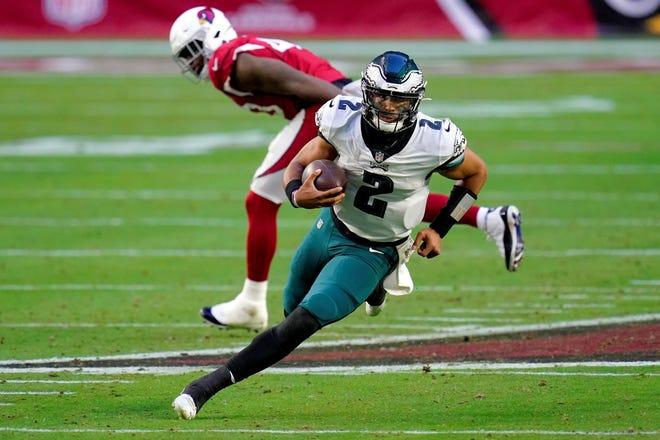 Philadelphia Eagles quarterback Jalen Hurts (2) scrambles against the Arizona Cardinals during the second half of an NFL football game, Sunday, Dec. 20, 2020, in Glendale, Ariz. (AP Photo/Ross D. Franklin)