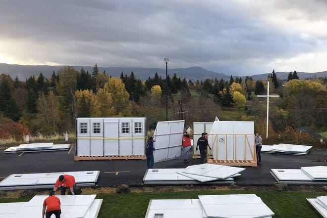 Temporary emergency shelters are assembled at the Hood River Valley Christian Church in Hood River, Ore., on Nov. 5, 2020. There are 13 Pallet shelters in the church parking lot. (Source: Ben Meadows / Hood River Shelter Services)
