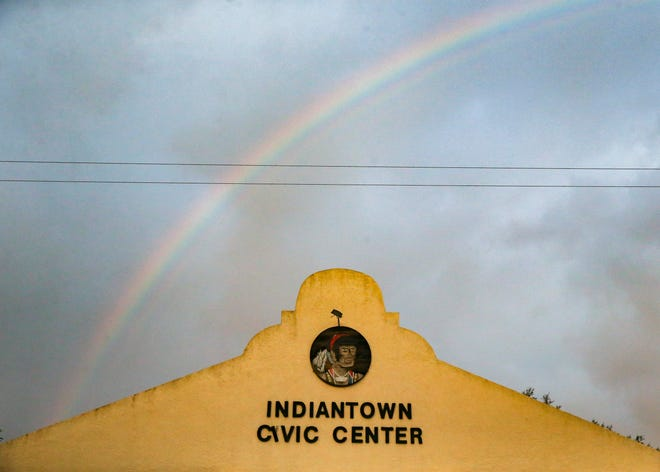 A rainbow appears behind the Indiantown Civic Center building after a storm on Saturday, Dec. 12, 2020, in Indiantown.