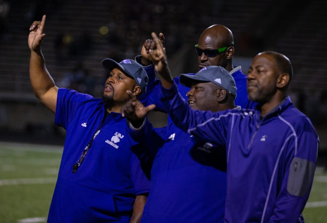 LBJ head coach Jahmal Fenner, left, celebrating a victory against Crockett, has filed a complaint with the Texas Association of Sports Officials regarding the school's loss to Lindale in the 4A DI state semifinals.