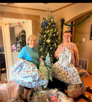 Jean Hoffman and Tasha Adams of VFW Post 2527 Ladies Auxiliary pose with gifts their group sponsored through CASA for five children in the foster care system.