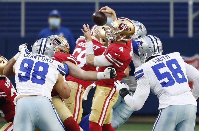 Dallas Cowboys defensive end DeMarcus Lawrence forces San Francisco 49ers quarterback Nick Mullens to fumble the ball during the Cowboys' 41-33 win Sunday. The Cowboys are plus-7 the past two games in turnover margin.