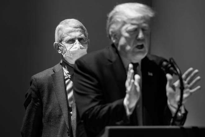 Dr. Anthony Fauci, the nation's leading infectious disease specialist, looks on in May 2020 as President Donald Trump speaks to reporters at the White House. (Samuel Corum/The New York Times)