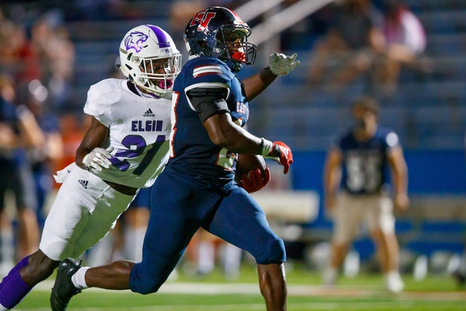 East View running back Isaiah Quinton-Jackson, running for daylight against Elgin, is among the players who have helped the Patriots reach the third round of the UIL State football playoffs.