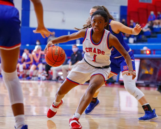 Westlake guard LaQuayla Chambers-Wells drives the to the basket against Hays during the third period at the District 26-6A girls basketball game on Monday at Westlake High School. The Chaps used pressure defense and transition buckets to stay unbeaten in district play with a 72-43 win.
