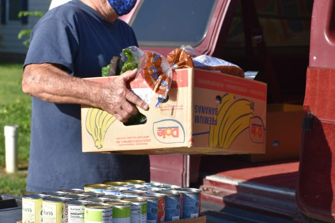 Bread, canned goods and vegetables are in boxes from the Bastrop County Emergency Food Pantry. The pantry has remained open during the coronavirus pandemic.