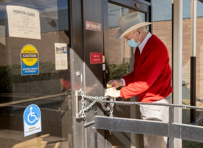Milam County Judge Steve Young locks up the permanently closed Little River Hospital in Cameron on Monday December 21, 2020.  The hospital closed in 2018 leaving Milam county without any hospitals.   The county purchased the building to be converted to county office space.