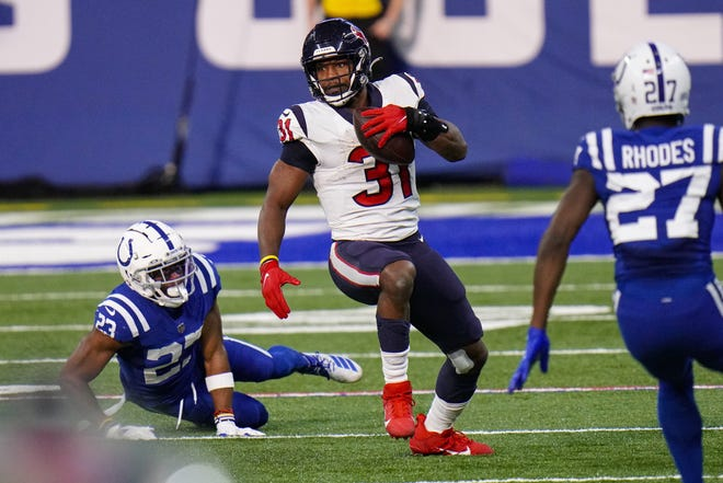 Houston Texans running back David Johnson posted career highs of 11 receptions for 106 yards in Sunday's loss to the Indianapolis Colts.