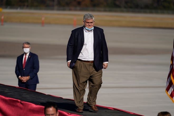 """In this Thursday, Dec. 10, 2020, file photo, David Shafer, chairman of the Georgia Republican Party, arrives before Vice President Mike Pence speaks during a """"Save the Majority"""" rally in Augusta, Ga. (AP Photo/John Bazemore, File)"""